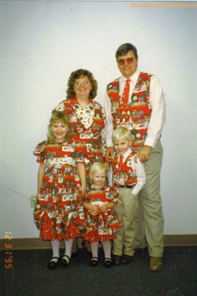 Family in Christmas vests