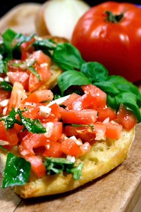 Bruschetta with chopped tomatoes, basil and cheese