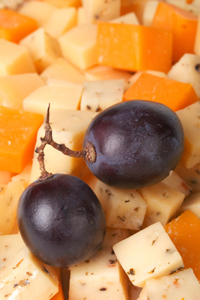 Cheese cubes with grapes