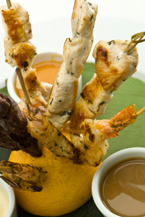 Chicken skewers and assorted dipping sauces