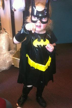 Girl dressed as Batman