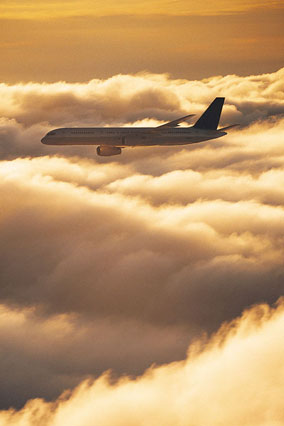 Airplane flying through clouds