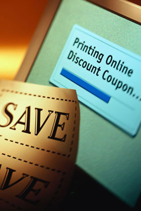 Online coupon being printed on computer