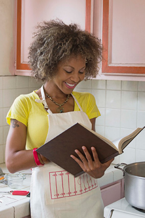 Woman reading a cookbook