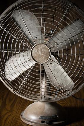Old fan covered in dust