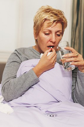 Woman taking medication before bed