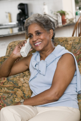 Gray-haired woman on phone