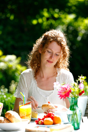 Woman having breakfast outside