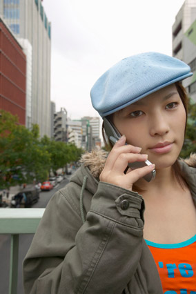 Woman listening to friend on mobile phone