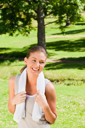 Woman with towel around her neck after her workout