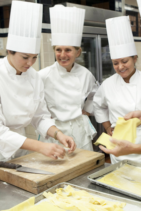 Cooking students making pasta