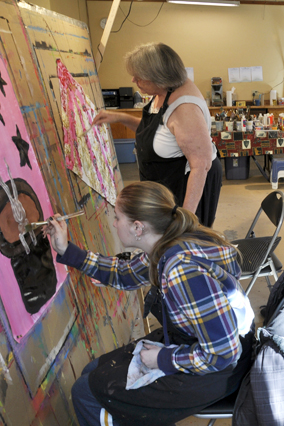 Women painting in art camp