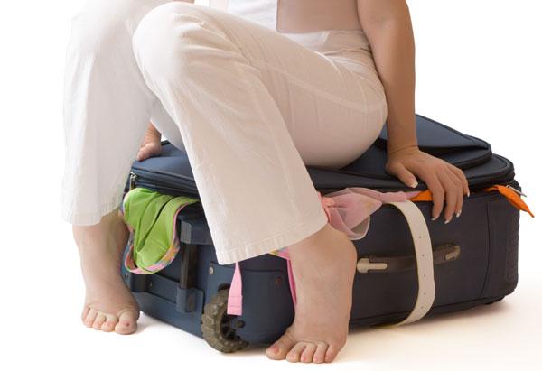 Sitting on suitcase