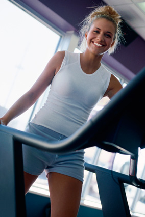 smiling woman on treadmill