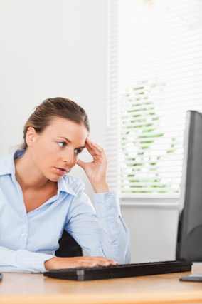 Woman looking up stressful information online