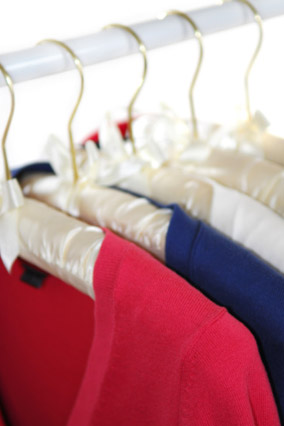 Clothes hanging neatly in a closet