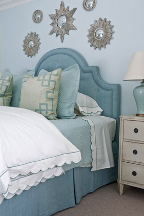 Powder blue bedroom with white bedding