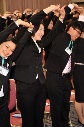 Japanese office workers doing organized stretching
