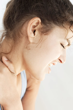 Woman clutching her shoulder in pain