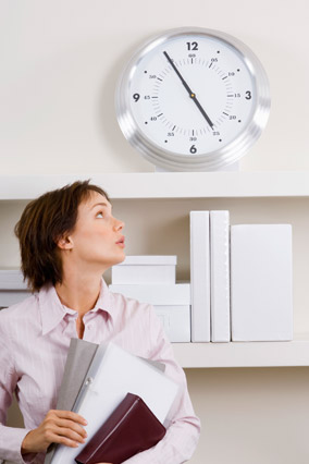 Woman running late and looking at the clock