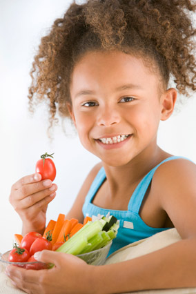 Young girl eating vegetables and crudite