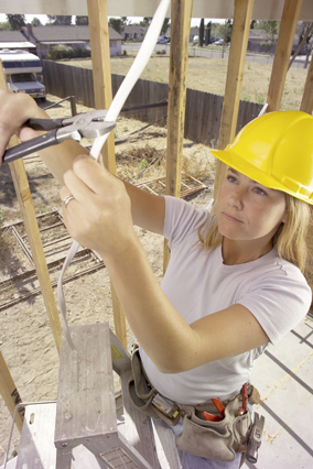 Woman setting up electricity in house