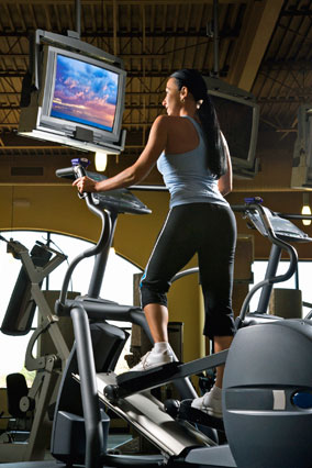 Woman watching tv on treadmill