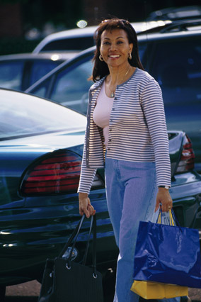 Woman walking through a parking lot