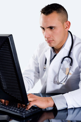 Male doctor at a computer