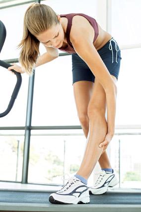 Woman with leg cramp