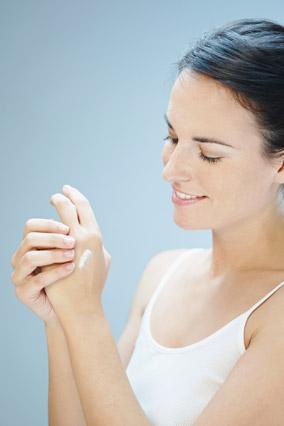 Applying deodorant to hands
