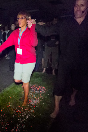 Gayle King walking on coals with Tony Robbins