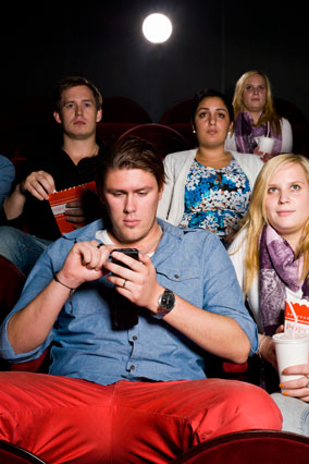 Texting at a movie theater
