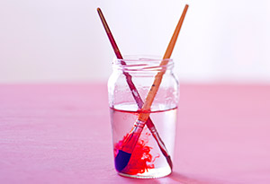 Paint brushes in a jar of water