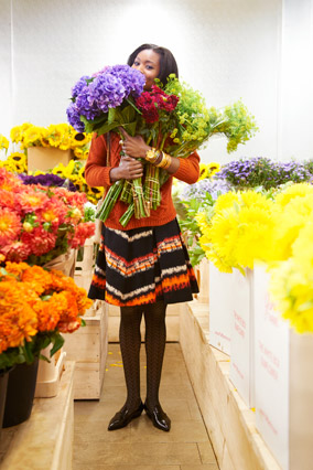 woman wearing full skirt carrying flowers