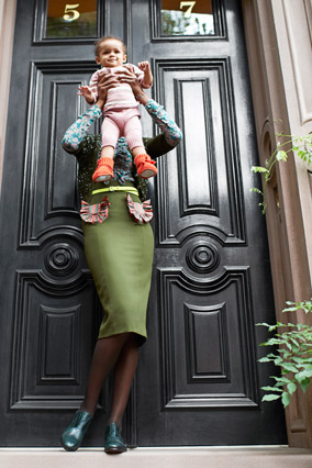 woman in midi skirt with baby