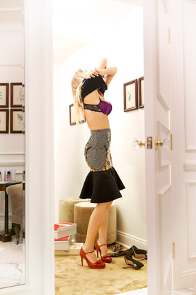 woman in changing room wearing trumpet skirt