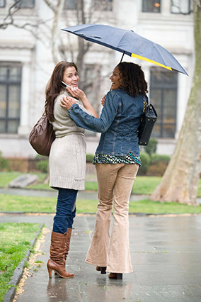 Woman sharing her umbrella