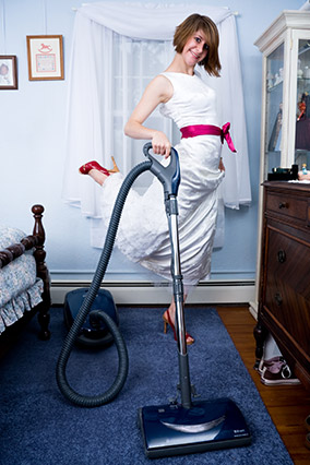 Vacuuming in a gown
