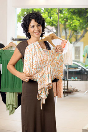Woman holding blouse up to chest