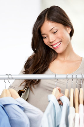 Woman looking at rack of collared shirts