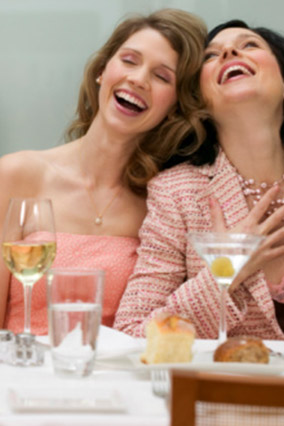 women laughing at a table