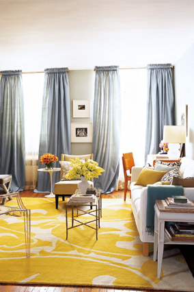 Room with yellow rug by Lance Boyd