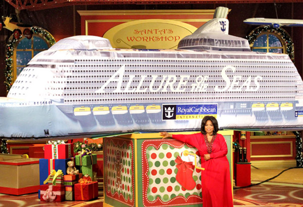 Oprah Winfrey in front of inflatable Allure of the Seas cruise ship
