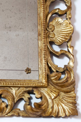 Corner of mirror in ornate gold frame
