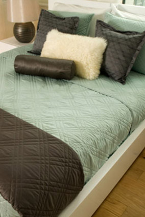 Turquoise bedding with brown accents