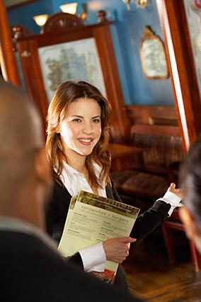 Restaurant hostess with menus