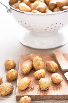 New potatoes in colander and on cutting board