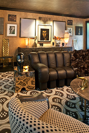 Leather couch in living room with multiple patterns