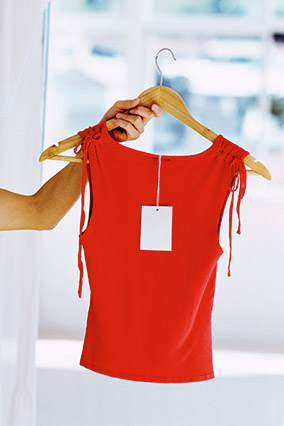 Red sleeveless shirt on wooden hanger